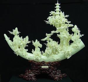 Cattle Bone Carving, 9501. This is a cattle bone carving. All hand carved with lots of detail.  L: 4in, H: 2in, W: 3.5in.