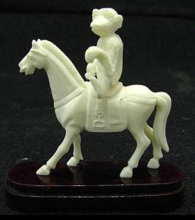 BONE SADDLED HORSE W/MONKEY (2106B)