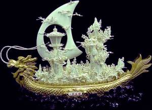 Item No. (01B1 ) 43 inches long. An Exquisite Elephant Bone and Gold Dragon Boat Carving Handmade in China Click on the dragon to see a larger picture.
