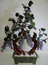 LAVENDER JADE GRAPES TREE (20A-4) THIS LOVERLY AND BEAUTIFUL JADE GRAPES VINES TREE IS MADE OF REAL JADE THAT IS IN LAVENDER COLOR. IT IS ABSOLUTELY MADE OF NATURAL REAL JADE WHERE THIS TYPE IS CALLED OIL JADE DUE TO ITS SHINING TEXTURE AND LOOK TRANSPARENT LIKE GLASS. THE LEAVES AND POT ARE MADE OF GREEN TAIWAN JADE. IT IS AN IDEAL DECORATION FOR YOUR LIVING ROOM, DINING ROOM, OFFICE AND KITCHEN.  SIZE: L 16in, H 21in, W 8in. PRICE  US $ 149.00 + S/H