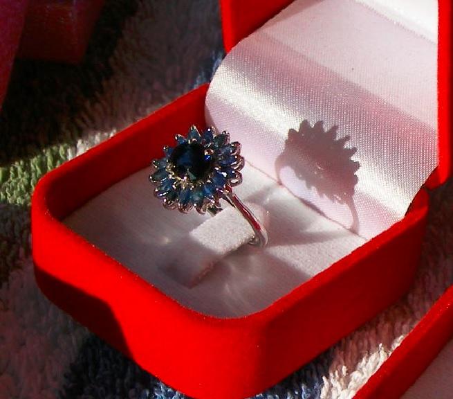 Sapphire  Price = $ 450.00 + S/H. SIZE: 6.5.