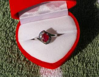 Ruby,  Price = $ 179.00 + S/H. SIZE: 6.5.