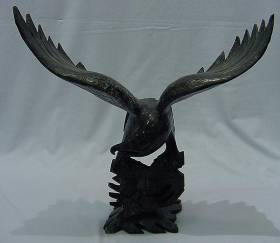 Exquisite LARGE 20 inch tall JADE EAGLE (LG7A) This Eagle is made from one solid piece of Liaoning Black JADE. It appears Very Dark Green. It is not joined together. A Very detailed carving. Size: L: 12in, W: 8in, H: 20in Carving Handmade in China. Click on the Eagle to see a larger picture.