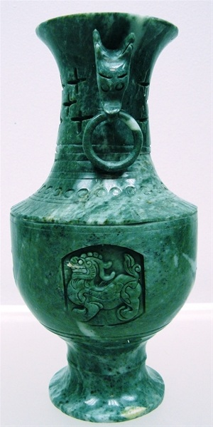 jade Buddha and Quanyin with dragon carving