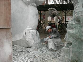 stone carving factory sculptor carving his work in China photo image