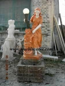 marble girl with lamp statue
